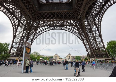 PARIS FRANCE - MAY 07 2015: View from bottom at famous Tour Eiffel in Paris France