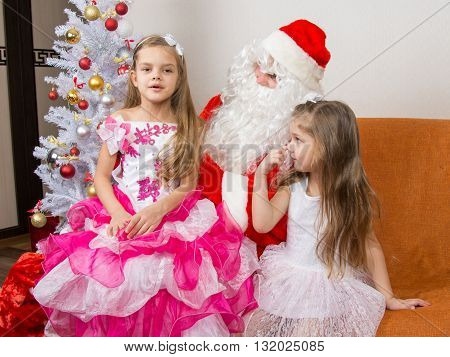 The Older Girl Is Sitting On The Lap Of Santa Claus And Tells Poem