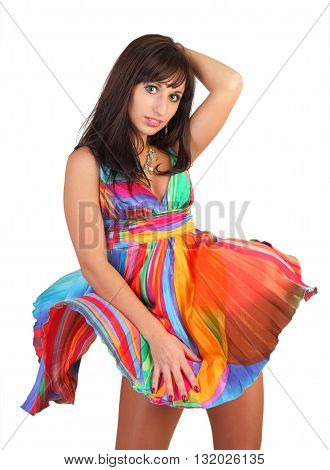 The fine girl in an easy bright fluttering dress the brunette