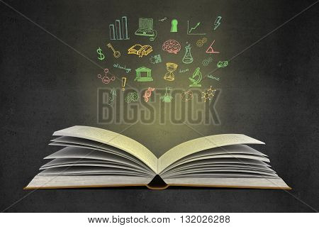 Idea concept with open book illuminated colorful business sketch on wall. Creative business sketching. Abstract image containing education and business objects
