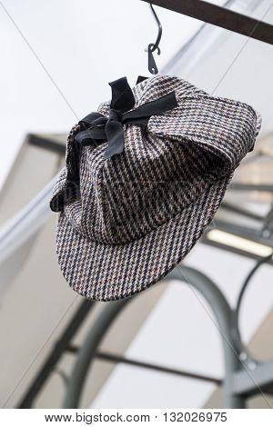 Deerstalker hat in houndstooth check with black ribbon
