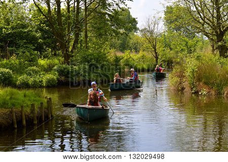Martin Mere Lancashire England UK - May 29 2016 : Tourists canoeing through the wetlands of Martin Mere