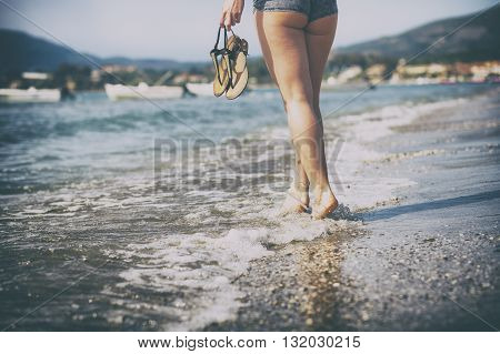 Woman Walking On Sandy Beach, Foots On Sea Waves