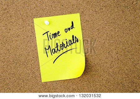 Time And Materials Written On Yellow Paper Note