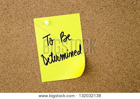 To Be Determined Written On Yellow Paper Note