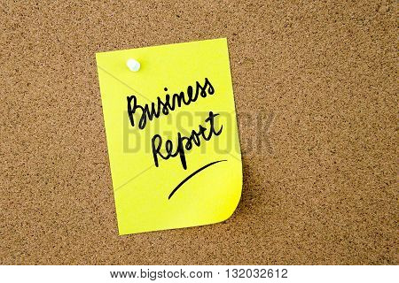 Business Report Written On Yellow Paper Note