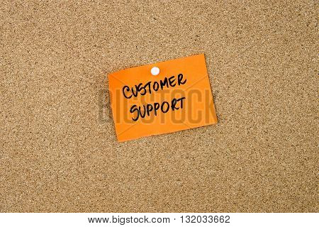 Customer Support Written On Orange Paper Note