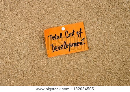 Tcd As Total Cost Of Development Written On Orange Paper Note