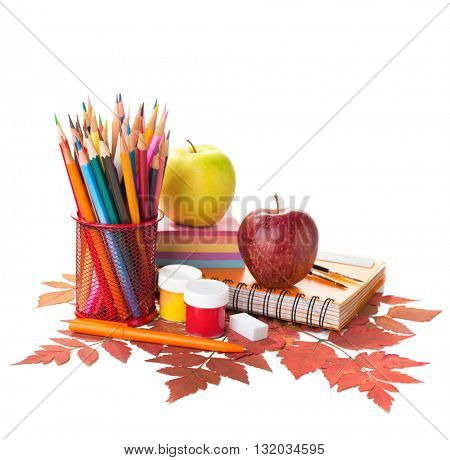 School supplies and autumn leaves isolated on white background