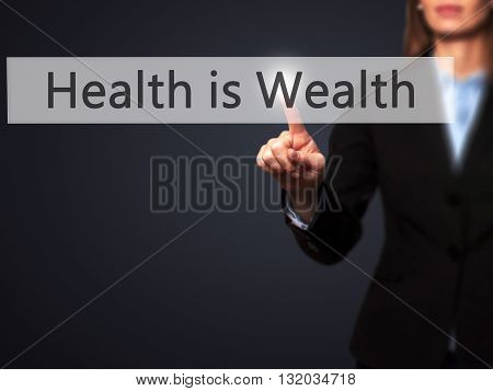 Health Is Wealth - Businesswoman Hand Pressing Button On Touch Screen Interface.