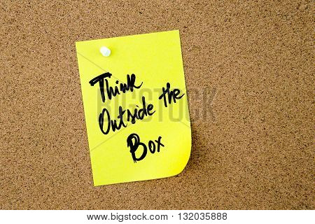 Think Outside The Box Written On Yellow Paper Note