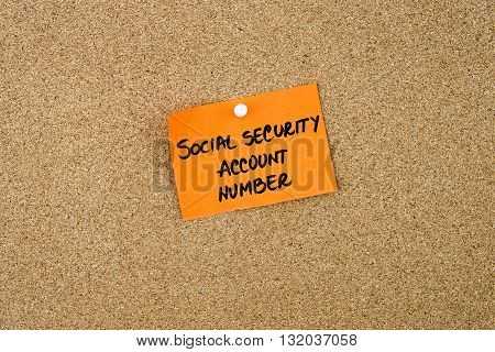 Social Security Account Number Written On Orange Paper Note