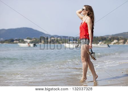 Happy Woman Walking On Sandy Beach Laganas Zakynthos Greece
