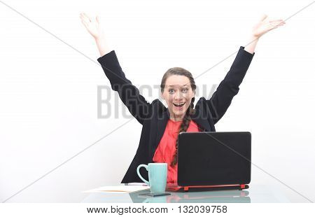Happy business woman celebrating success with hands raised in the air