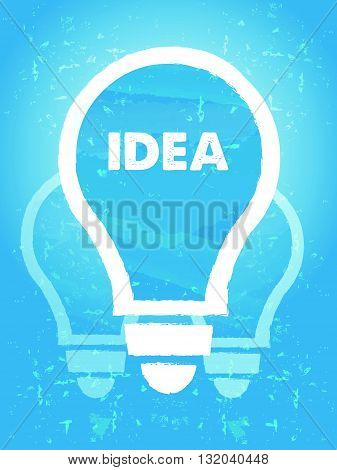 idea in bulb symbol - text and sign over blue grunge background, flat design, business creative concept, vector