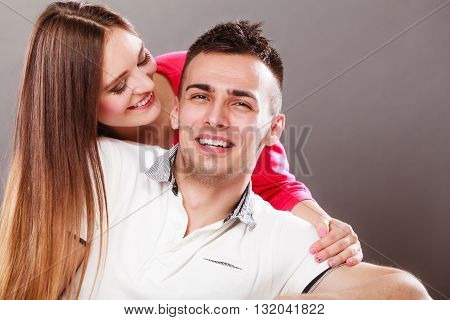Woman kissing man in cheek. Wife and husband flirting. Happy joyful couple. Good relationship.