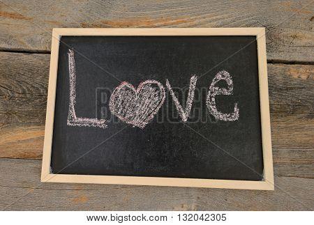 love written in chalk on a chalkboard on a rustic background