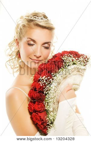 Beautiful young bride with luxury bouquet of red roses. Isolated on white background