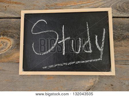 study written in chalk on a chalkboard on a rustic background