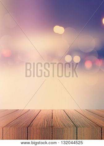 3D render of a wooden deck looking out to a defocussed background with bokeh lights