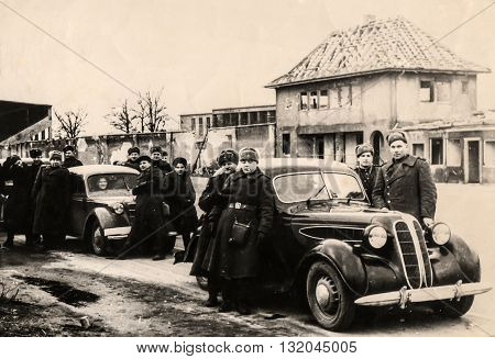 Berlin, Eastern Germany - March, 1945: Russian soldiers on the way to  Belnin. Soon the Victory Day