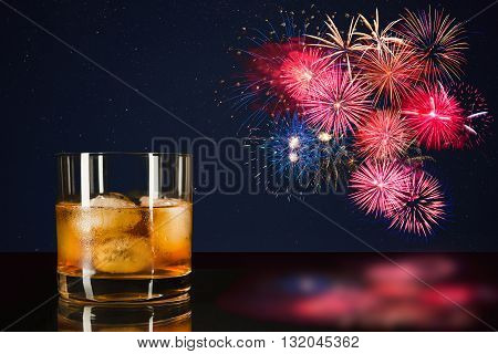 Whiskey and celebration colorful fireworks. Amazing fireworks over night sky. 4th of July. Independence Day.  Holidays salute of various colors on night sky.