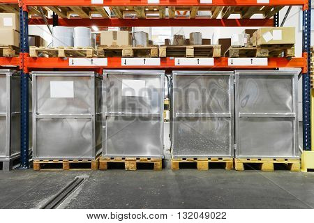 Metal Containers at Pallets in Warehouse Shelf