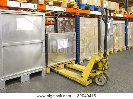 Yellow Pallet Jack Truck in Distribution Warehouse