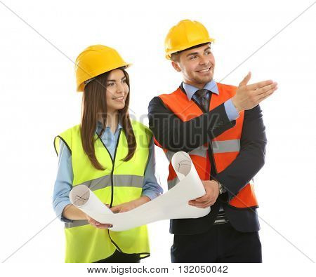 Man and woman in vests with engineering blueprint isolated on white