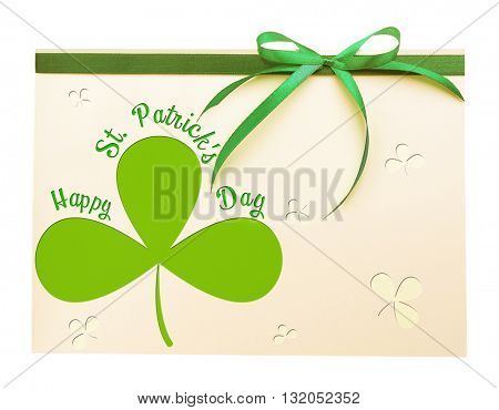 Card decorated with green bow isolated on white. Happy St. Patrick's Day