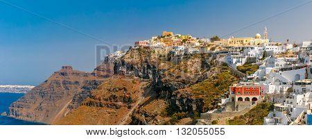 Panorama of Fira, modern capital of the Greek Aegean island, Santorini, in the sunny day, Greece