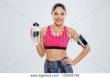 Smiling woman holding shaker with water isolated on a white background