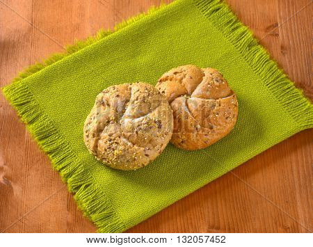two fresh buns on green place mat