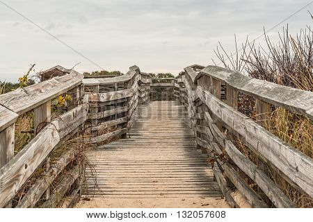 Wooden pathway to beach at First Landing State Park in Virginia Beach, Virginia.