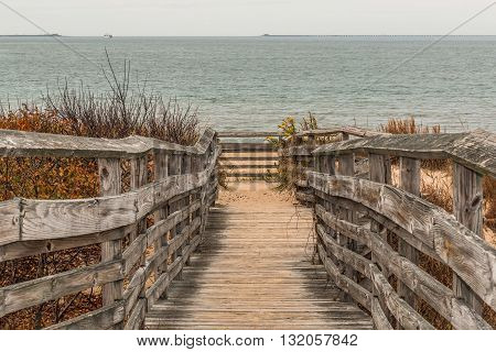 Pathway to beach with ocean background at First Landing State Park in Virginia Beach, Virginia.