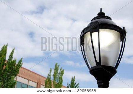 Street Lamp Next To A Brick Buidling