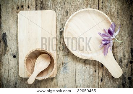 Top view of wooden bowl on old wooden background.