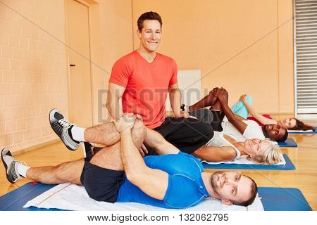 Trainer and people during rehab class following instructions from coach