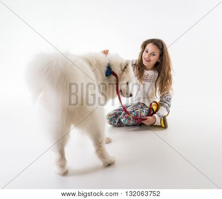 Adorable little girl with white dog