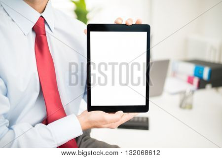 Man holding a tablet with a blank screen