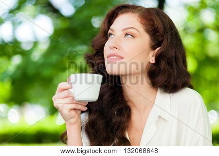 Beautiful woman drinking a coffee outdoor