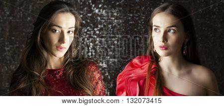 Portrait of Young brunette women on dark studio wall background