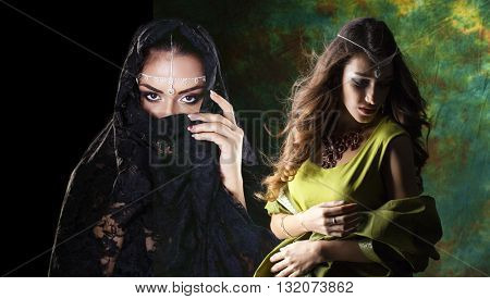 Young beautiful brunette women in indian green and black dress