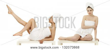 Full length portrait of a beautiful young women wrapped towel isolated on white background