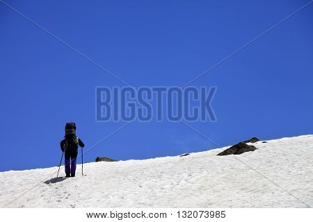 Hiker in snowy mountains at spring. Turkey Kachkar Mountains (highest part of Pontic Mountains).