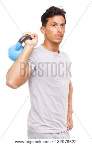Fit young man lifting a kettlebell, isolated on white background
