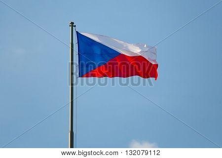 Czech flag waving against blue sky