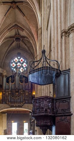 Bayonne France - May 21 2016: Pipe organ and pulpit in nave of Cathedral of Sainte-Marie de Bayonne Cathedral. Bayonne Aquitaine. France
