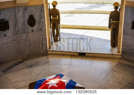 Santiago de Cuba Cuba - January 10 2016: Guard mounting or changing the guard at the Mausoleum of Jose Marti in the cemetery of Santa Ifigenia in Santiago de Cuba. The soldiers guarding the national hero Jose Marti decked sargofag
