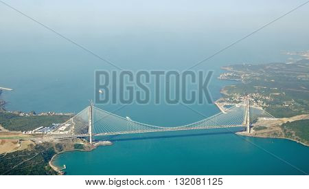 Aerial view of the Third Bosphorus Bridge the Yavuz Sultan Selim Bridge close to the Black Sea. Linking Europe and Asia north of Istanbul the bridge carries both a motorway and railway line.